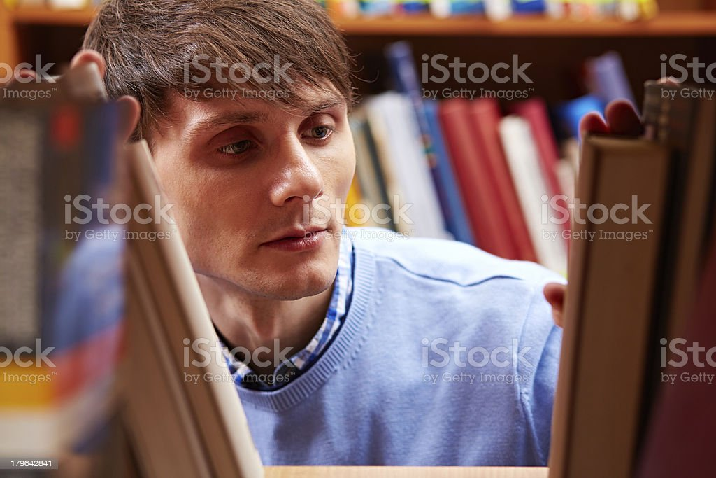 Searching for a book royalty-free stock photo