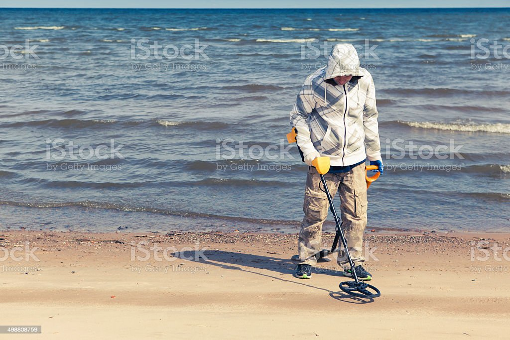 searching for a precious metal with a metal detector stock photo
