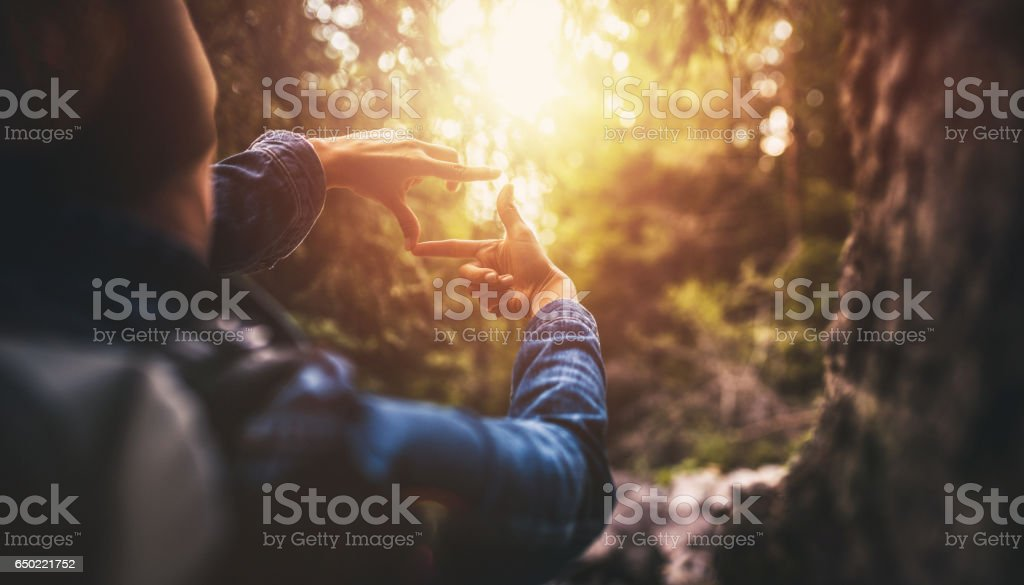 Searching for best composition at sunset stock photo