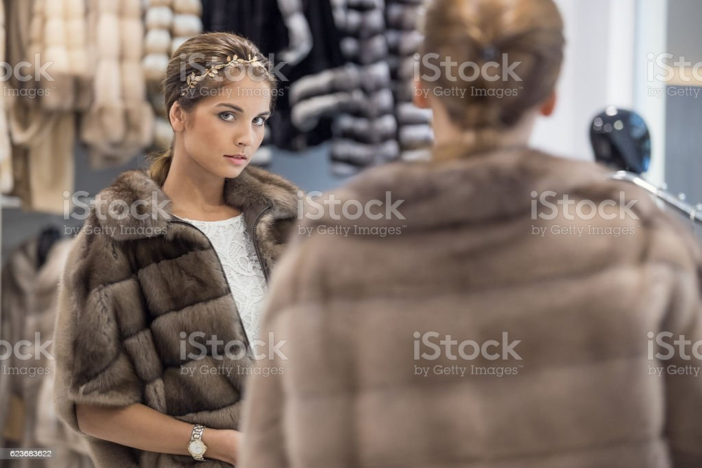 Searching for perfect fur coat stock photo