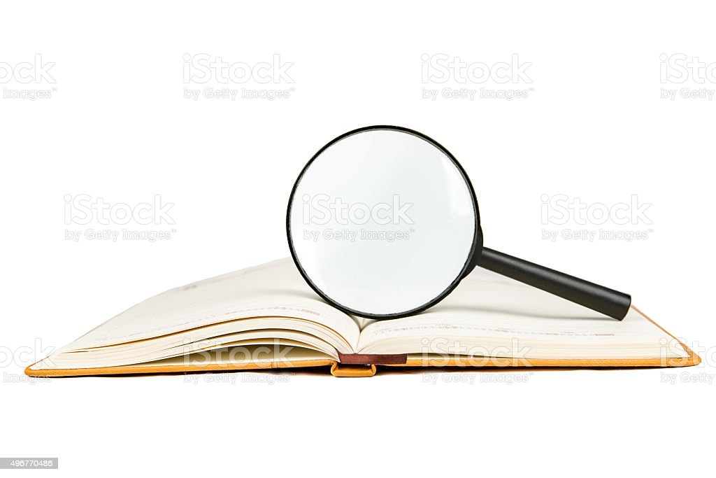 Searching, opened book and magnifier glass, side view, isolated White stock photo