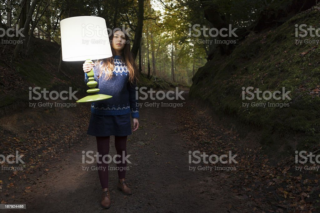 Searching outdoors with illuminated lamp royalty-free stock photo