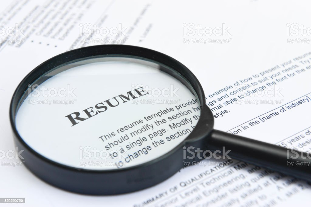 Searching Resume - Concept for using Magnifying Glass to find the Resume of candidate stock photo