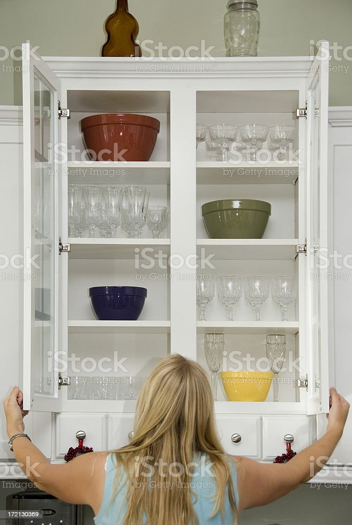 Searching the Cupboard stock photo