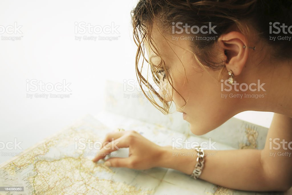 Searching the map royalty-free stock photo
