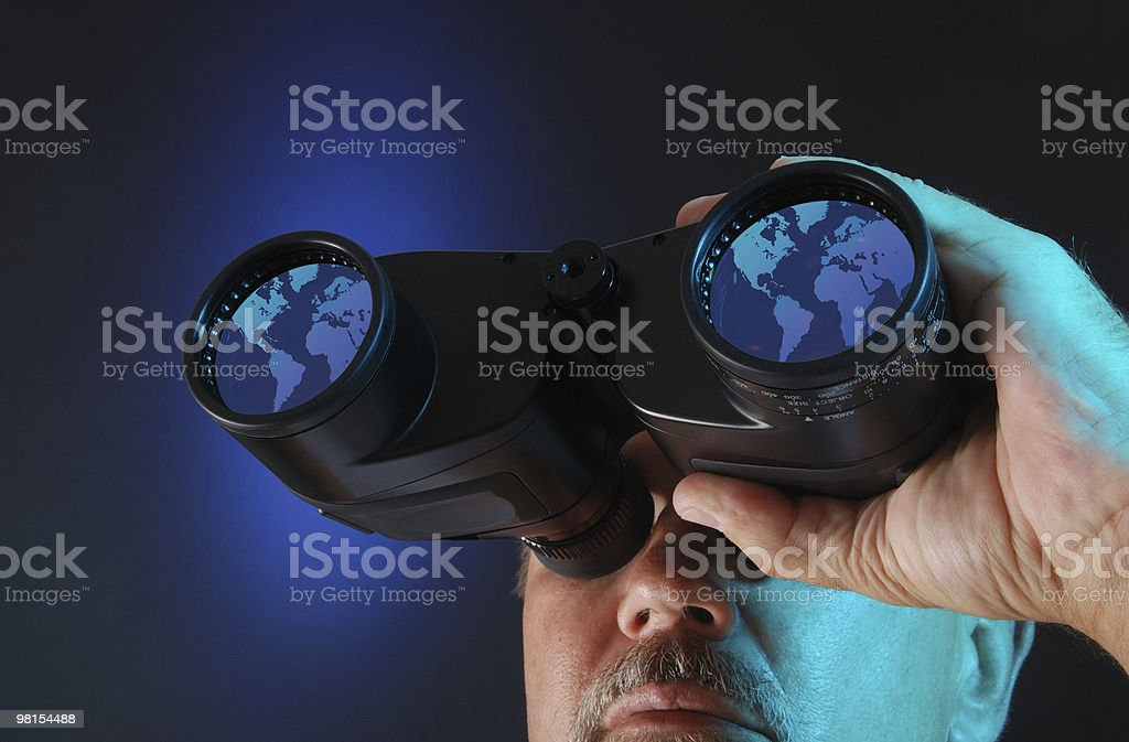 Searching the World Through Binoculars stock photo