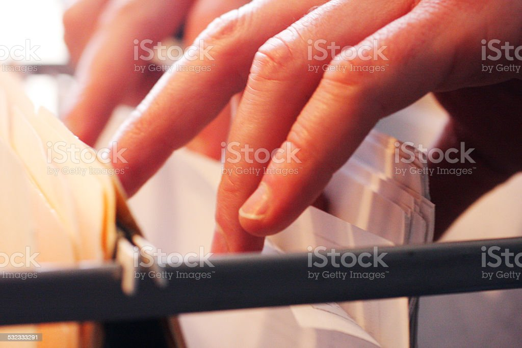 Searching Through Files stock photo