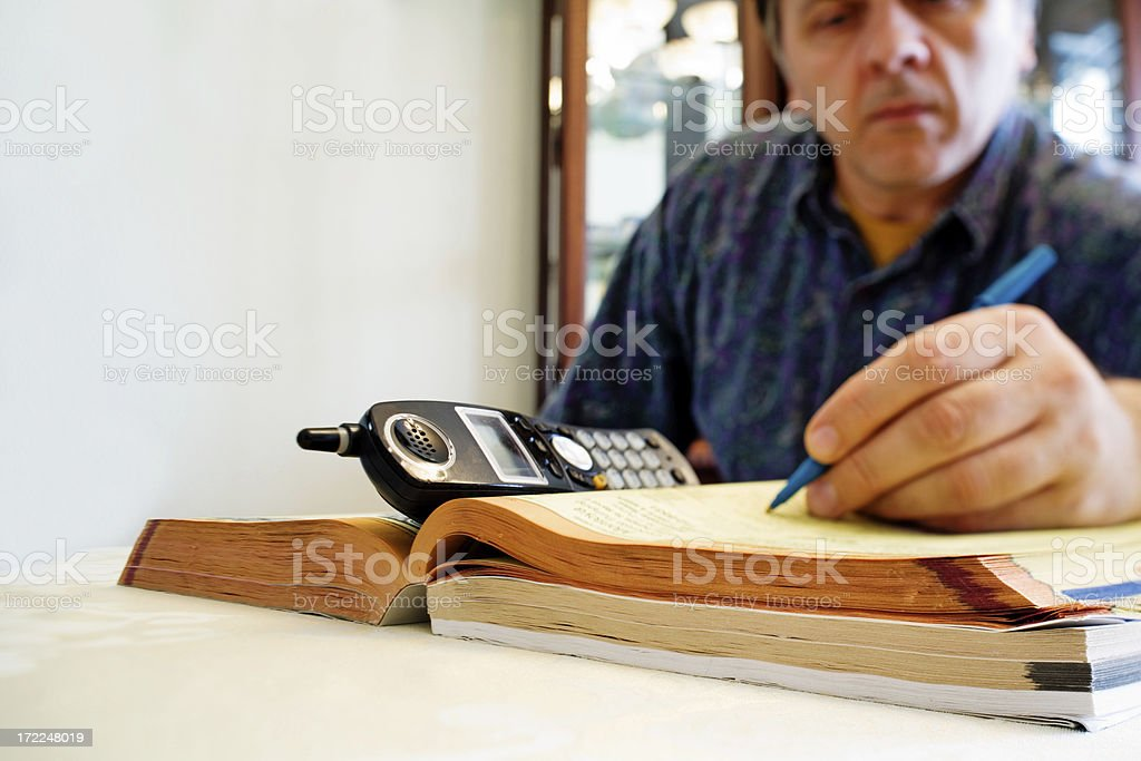 Searching Yellow Pages stock photo