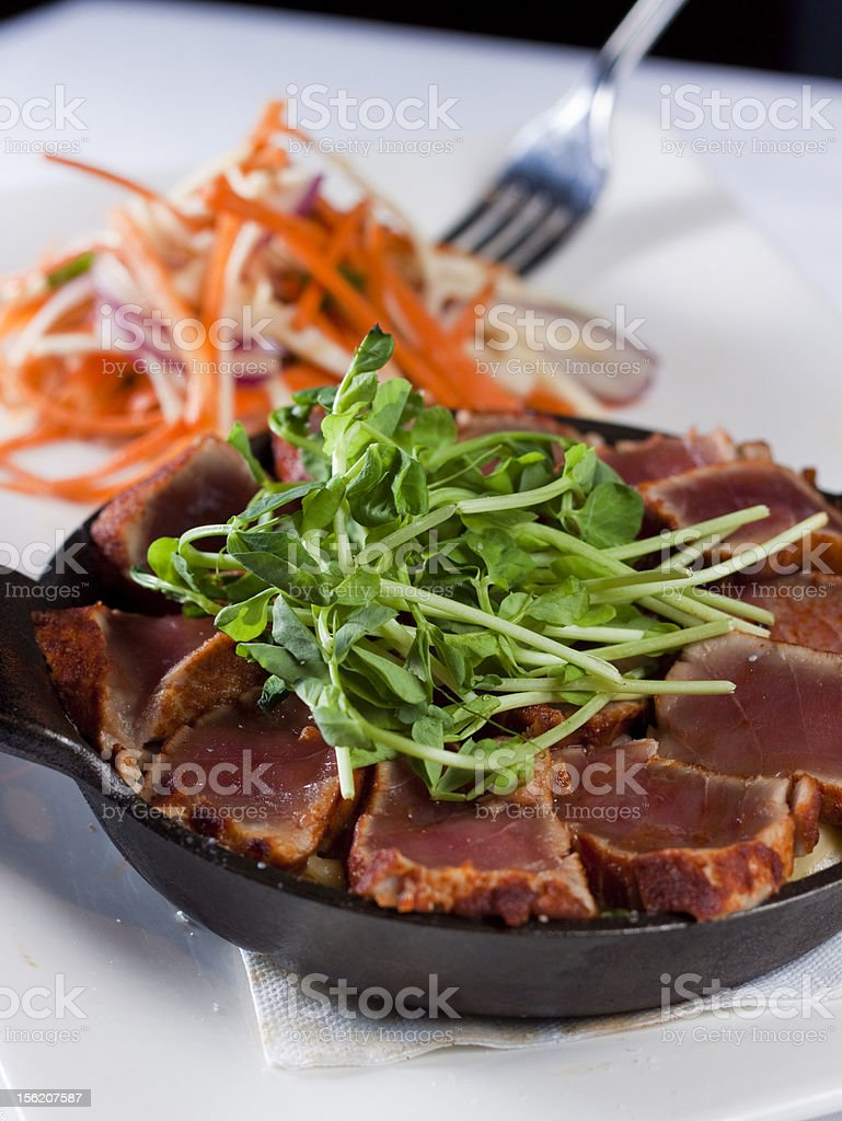Seared Ahi Tuna Casserole with Julienned Salad royalty-free stock photo