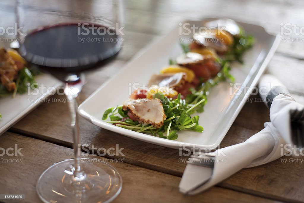 Seared fish salad with wine stock photo
