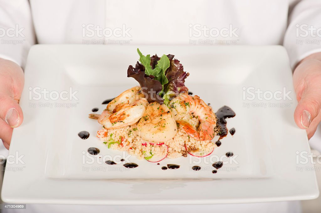 Seared Scallops and Prawns with Couscous royalty-free stock photo