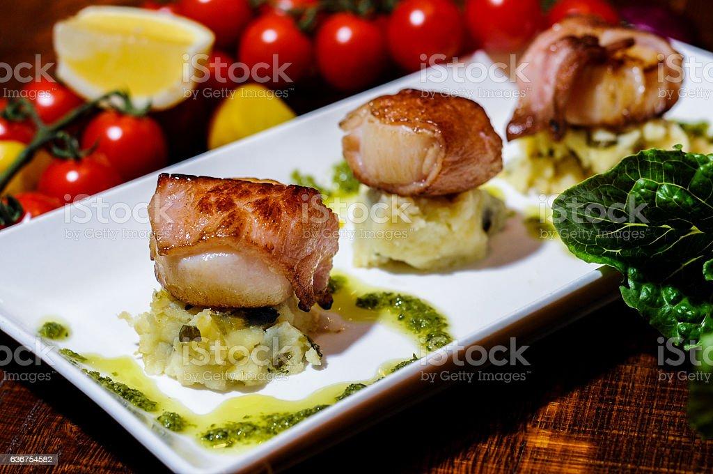 Seared scallops wrapped in panchetta stock photo