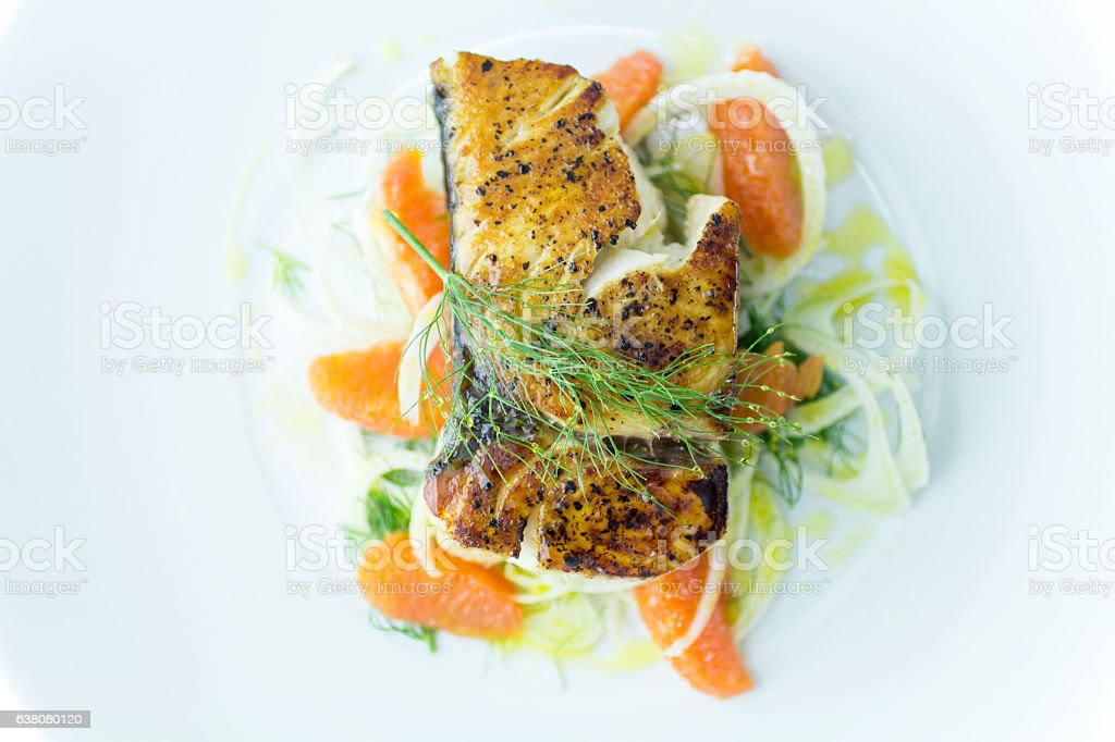 Seared Wahoo Fish Fillet with Fennel Orange Salad stock photo