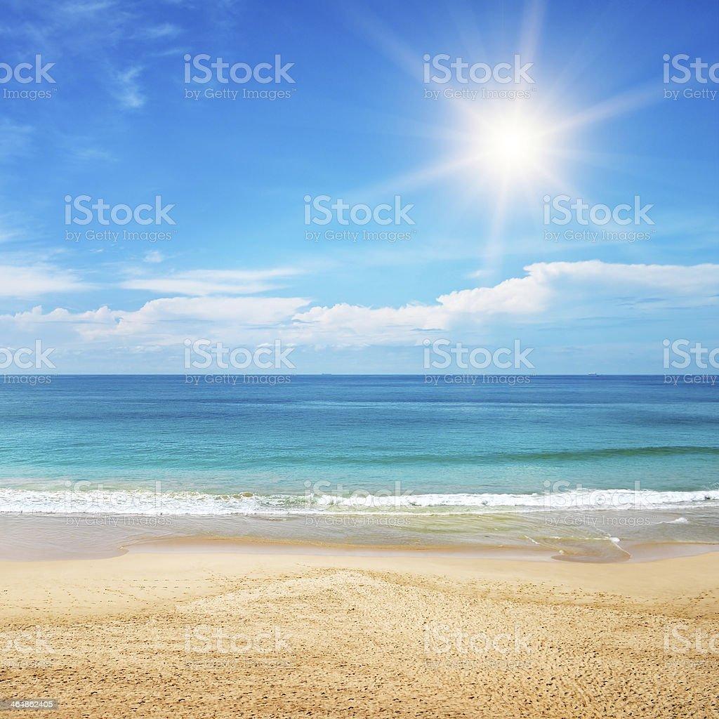 seascape and sun on blue sky background stock photo
