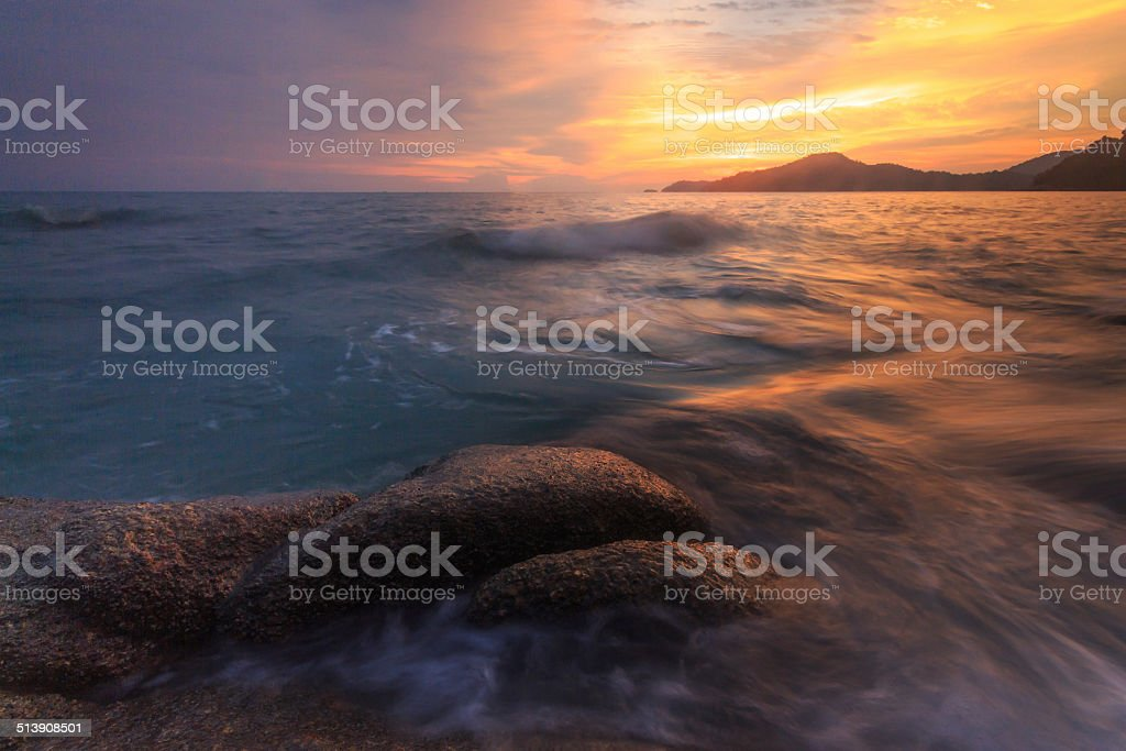 Seascape at teluk batik during sunset. stock photo