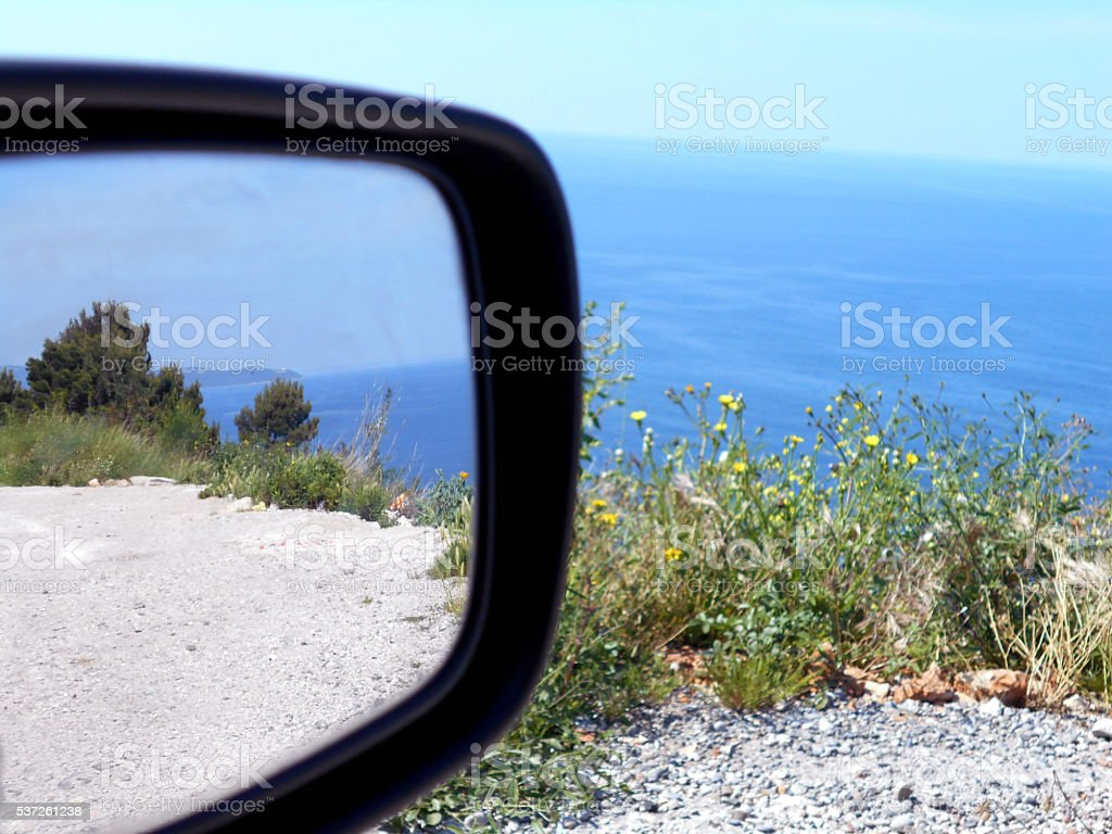 Seascape in a rear-view mirror stock photo