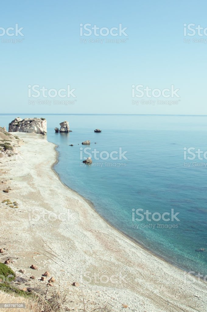 Seascape in minimalist style with coastline and boulder on horizon stock photo