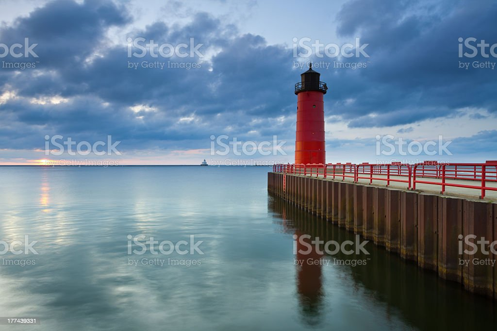 Seascape of Milwaukee Lighthouse with flat calm sea  stock photo