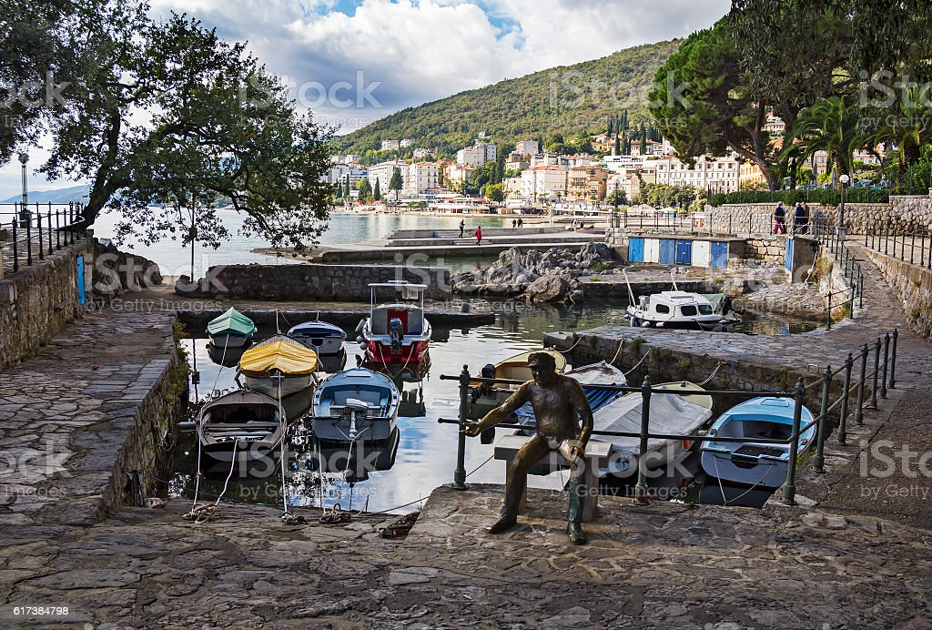 Seascape Opatija in Croatia with Sculpture of the fisherman stock photo