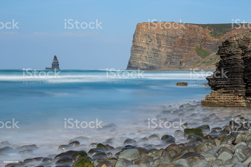 Seascape stone needle. Aljezur. stock photo
