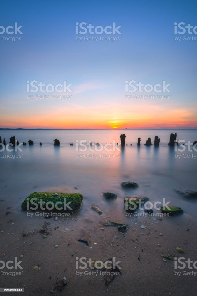 Seascape sunset over the bay stock photo