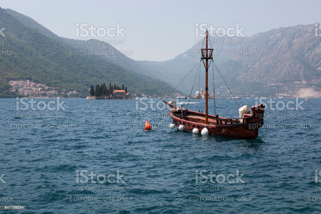 Seascape with a boat and islands in the Boka Bay of Kotor. stock photo