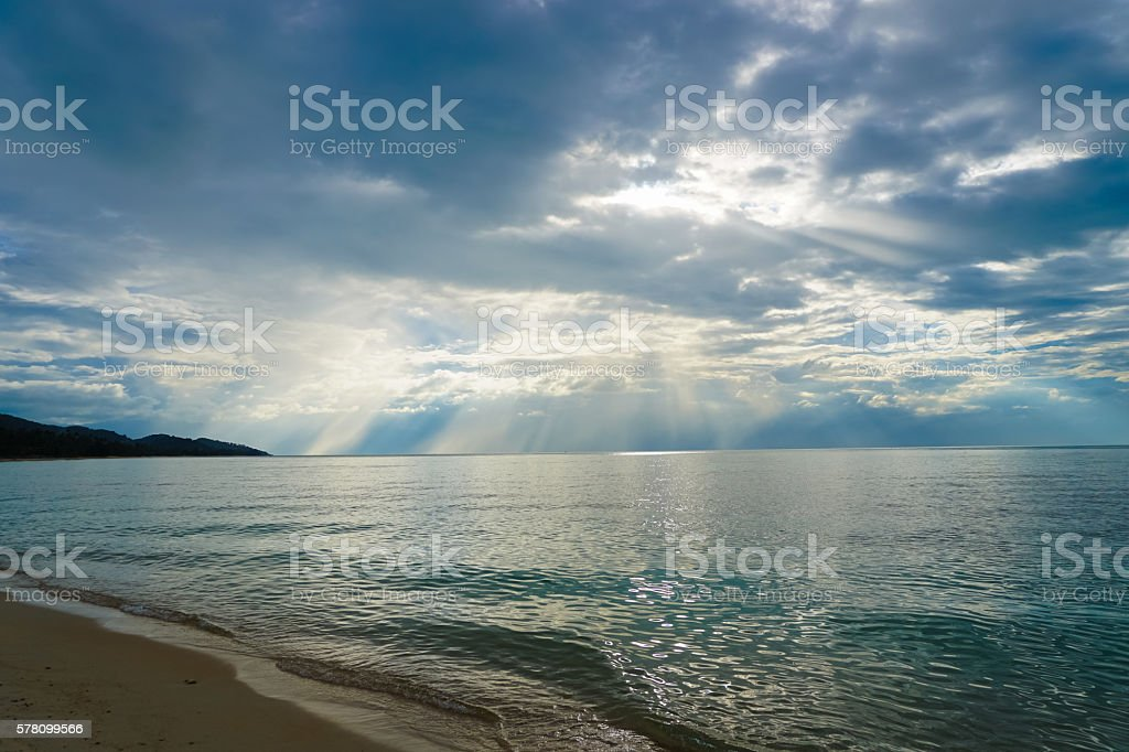 Seascape with Beams of light go through clouds stock photo