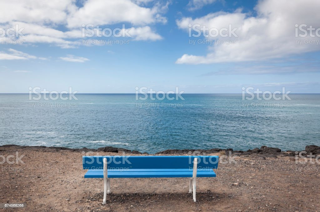 Seascape with bench stock photo