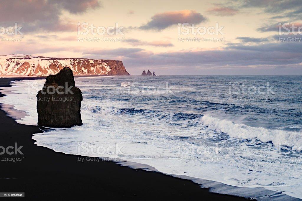 Seascape with  black sand Reynisfjara beach and  rocks, Vik,Iceland stock photo