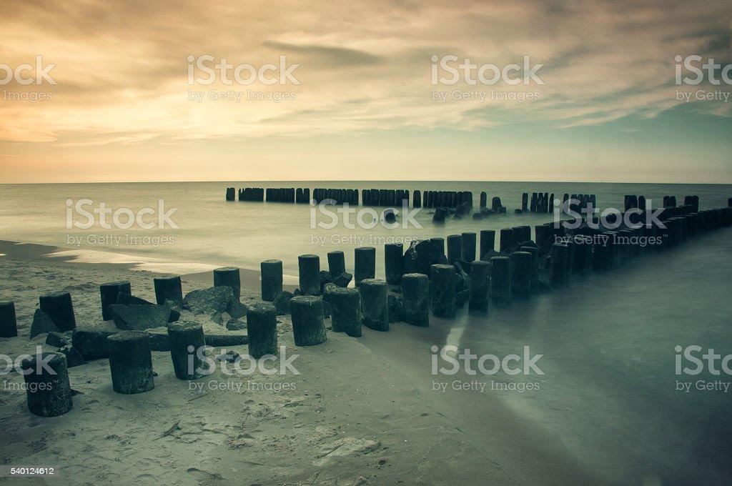 Seascape with breakwaters. vintage landscape polish sea shore stock photo