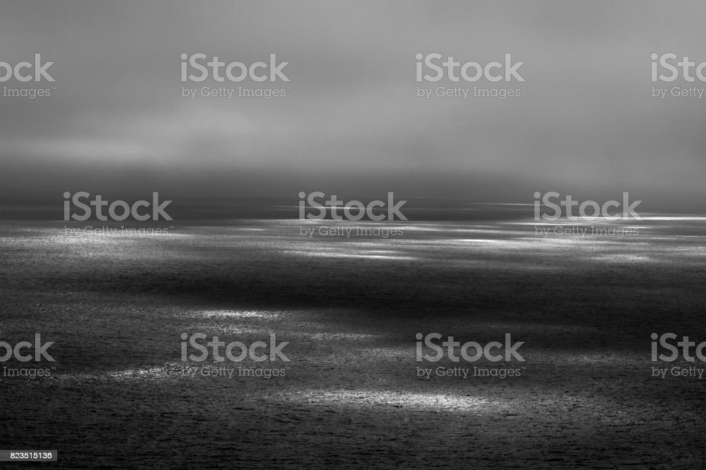 Seascape with ethereal sunbeams on the surface. stock photo