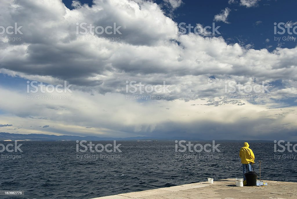 Seascape with Fishing Man stock photo