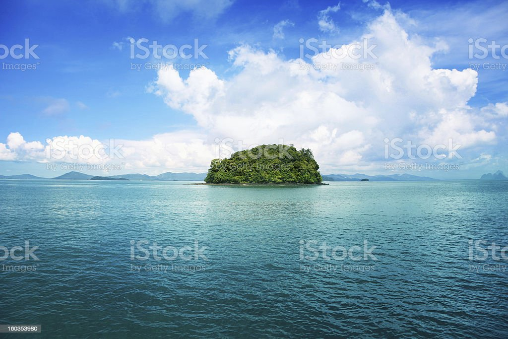 Seascape with green island. stock photo