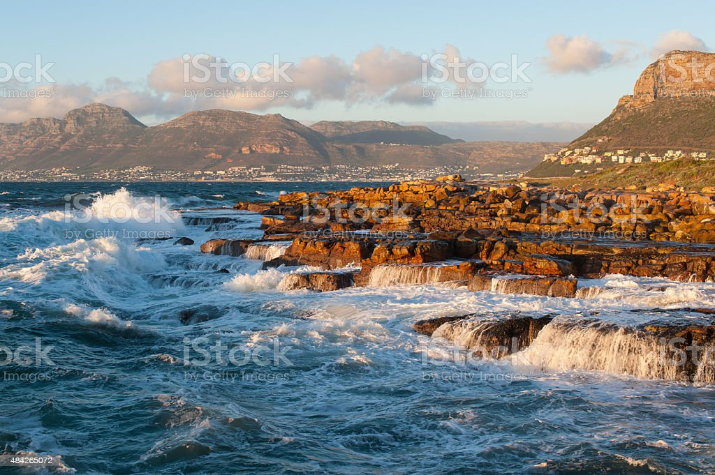 seascape with rocky coastline and breaking waves, south africa stock photo