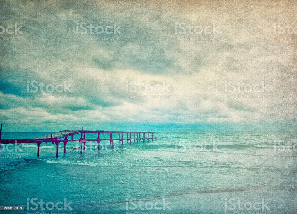 Seascape with wooden pier stock photo