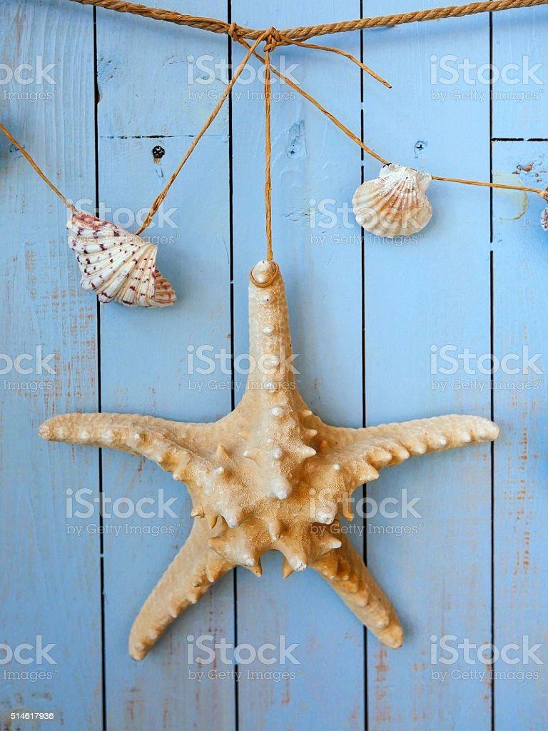 Seashells hanging on the rope, vintage styling stock photo