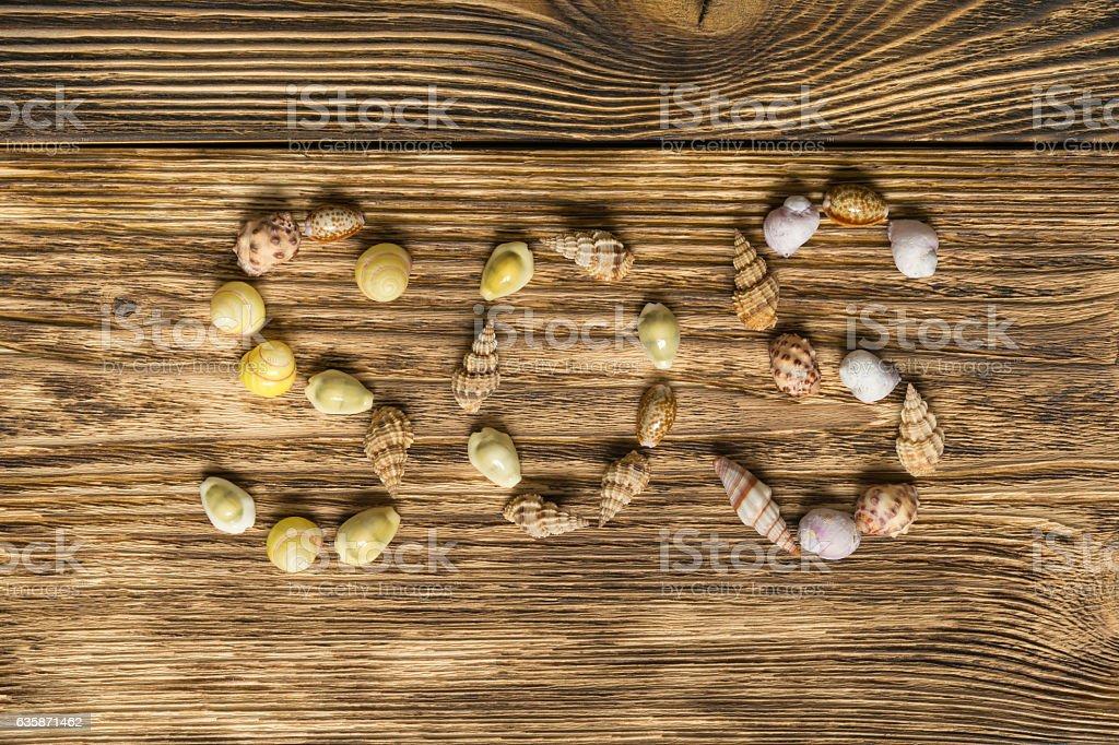seashells laid out inscription SOS stock photo