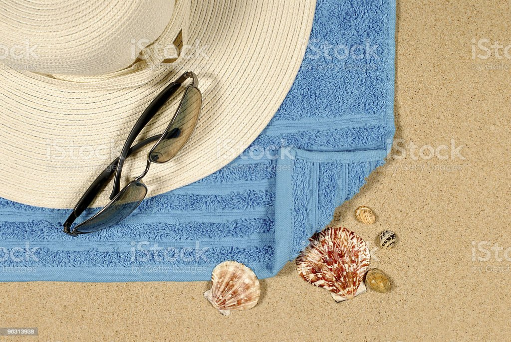 Seashore background with hat and sunglasses royalty-free stock photo
