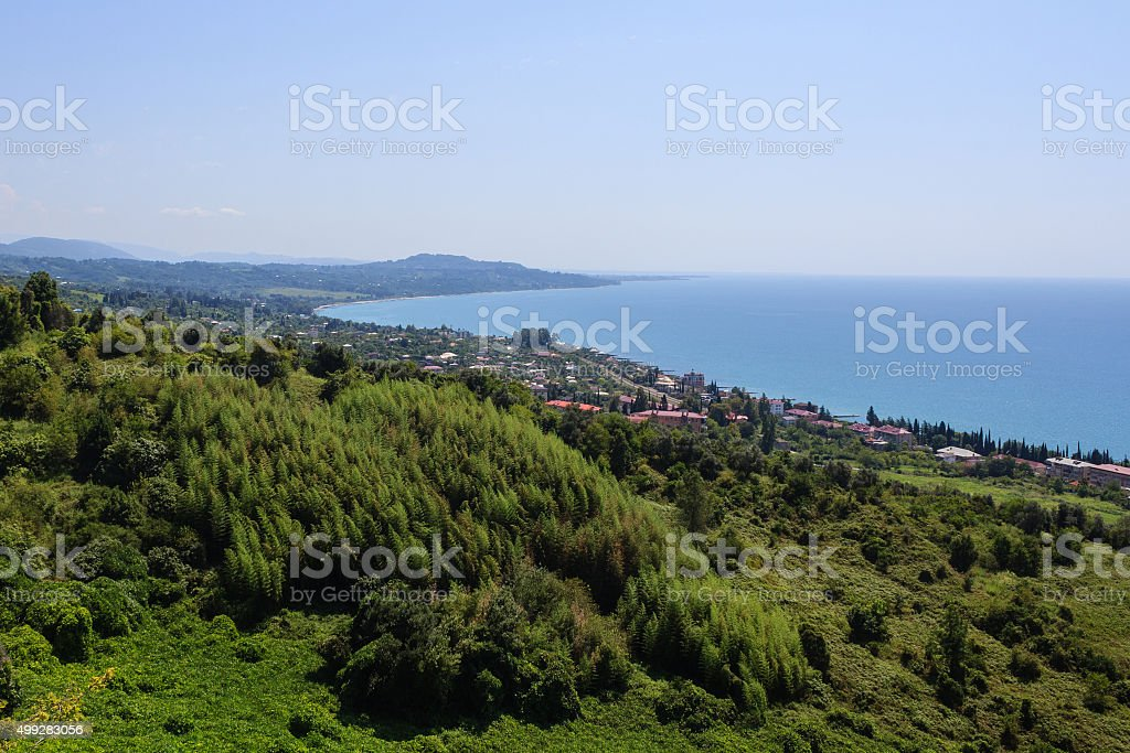 seashore landscape with green forest and houses in New Athos stock photo