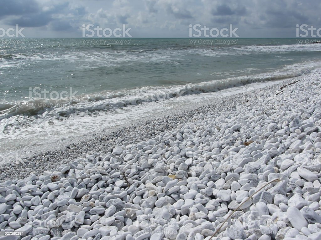 Seashore of a beach in a cloudy day at summer stock photo