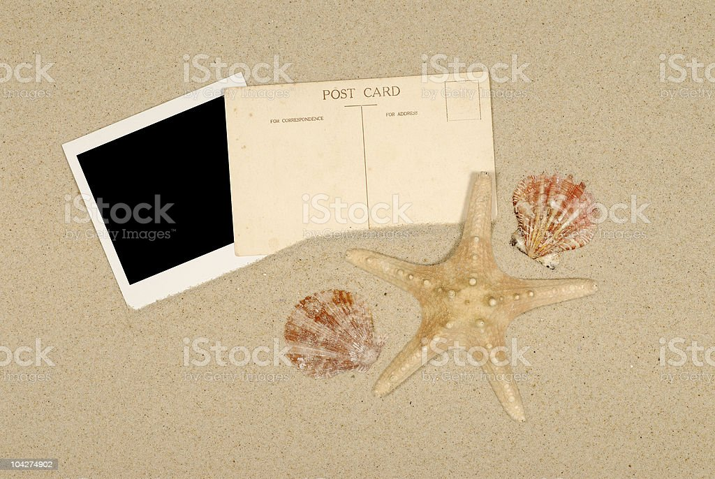 Seashore scene with instant photo print, starfish and postcard royalty-free stock photo
