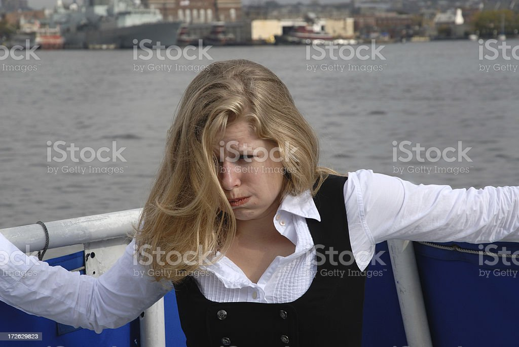 Seasick Young Woman in Boat royalty-free stock photo