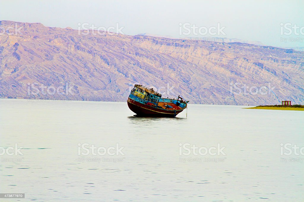 Seaside and the boat by the water royalty-free stock photo