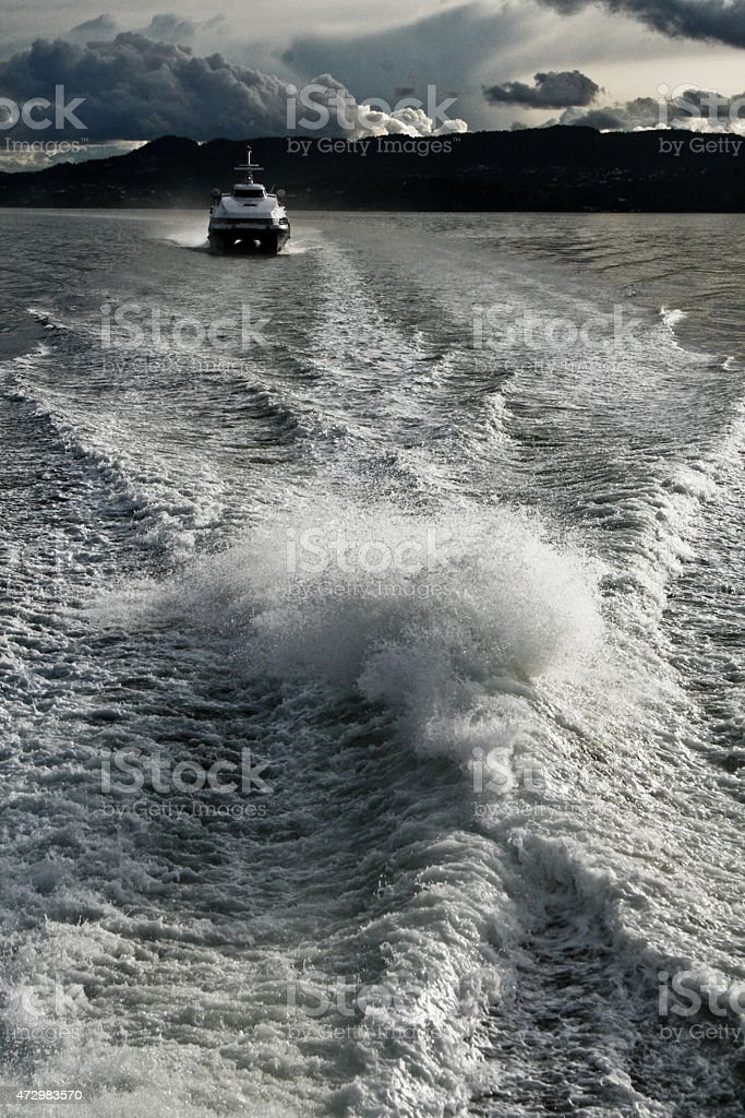 Seaside and the boat in the water royalty-free stock photo