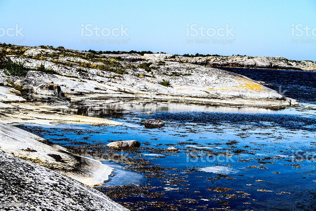 Seaside and the stones by the water royalty-free stock photo