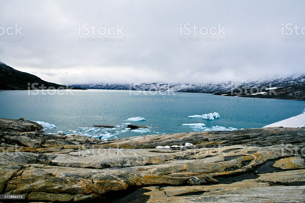 Seaside and the water by the mountain in winter royalty-free stock photo