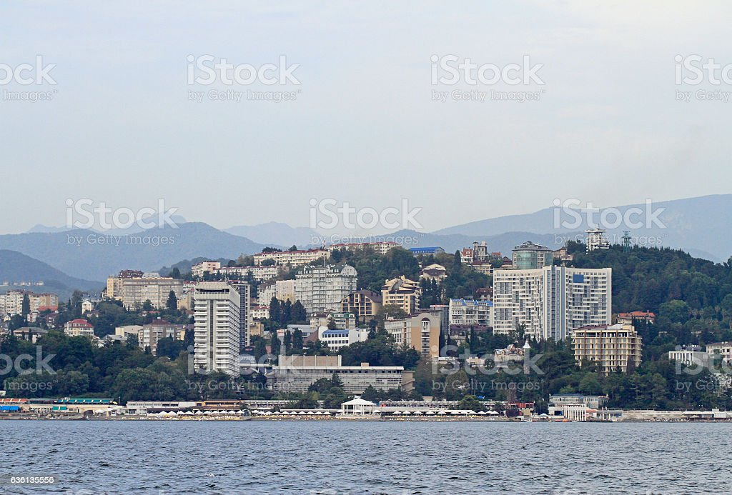 seaside, buildings and mountains in Sochi stock photo
