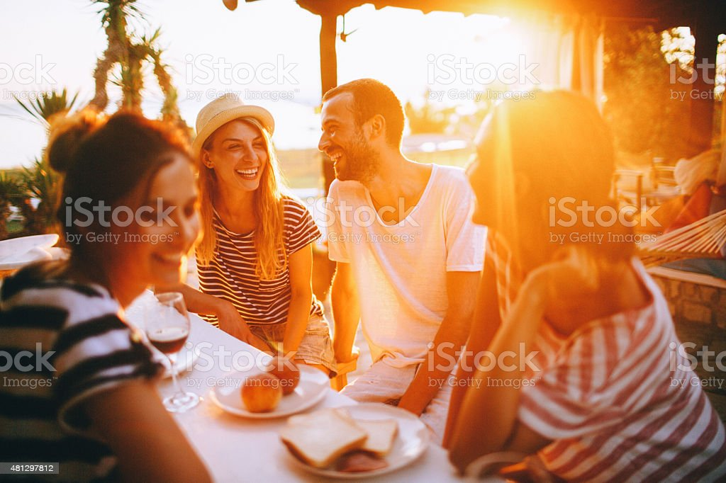Seaside dinner party stock photo