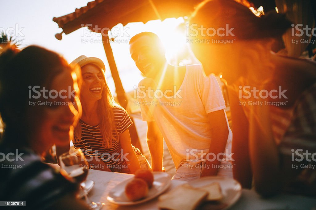 Seaside dinner party stock photo
