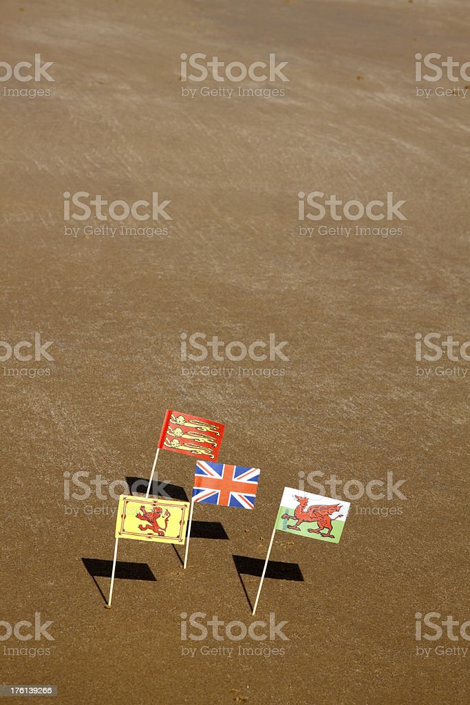 Seaside flags and sand stock photo